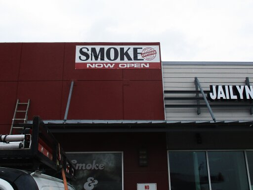 Smoke shop banner by Hightech Signs